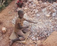 """A second and very sad reality of life in Kabubbu was the sight of children working in a quarry – hot, noisy, hard work. Allison said of the quarry, """"this is where Adam works, and despite being sponsored and having Downs he still comes to the quarry and breaks stones. I was shown his pile of stones which is just across the pathway to his mum's much bigger pile."""